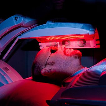 A man undergoes photodynamic light therapy for rosacea.